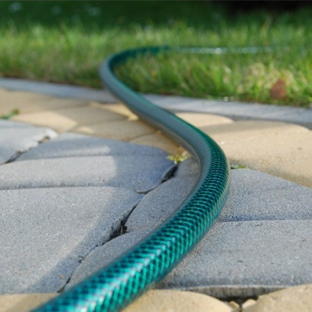 Green Hose In Garden