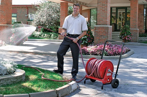 Man Using Portable Hose Reel